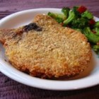 Famous Pork Chops - Pork chops coated with a crumbly cracker mixture and egg then baked.