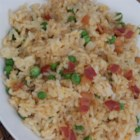 Breakfast Fried Rice - Breakfast fried rice, made with eggs, bacon, and onion, will provide a hearty breakfast on a weekend morning.