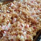 Peppermint Rice Crispies Squares - Crushed peppermint candies are stirred into the traditional rice cereal treat for a minty twist during the Christmas season.