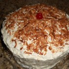 Pina Colada Rum Cake - Delicious, moist chilled dessert with rum, coconut and whipped frosting.