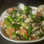 Seafood and Asparagus with Linguine - Clams and asparagus are steamed over shrimp, mushrooms and scallops in a wine broth, then tossed together and served over linguine with freshly grated Parmesan cheese.