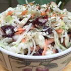 Cranberry-Poppy Seed Coleslaw - This tasty slaw recipe calls for Napa cabbage, dried cranberries, roasted sliced almonds, and poppy seed dressing.