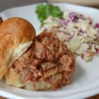 BBQ Pork for Sandwiches - Mouth-watering pork cooked in a slow cooker with beef broth served with barbecue sauce.