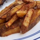 Spicy Chili French Fries - These spicy baked fries are very easy to make, and a great way to kick up your burger platter.
