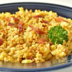 Scrambled Cauliflower - Low Carb - Mixed with eggs, Cheddar cheese, and Parmesan cheese, this low-carb recipe for scrambled cauliflower is sure to become a brunch favorite.