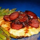 Raspberry Kielbasa over Cheese Grits - This is a quick and easy recipe, but very impressive because of the unique flavor.  One of my family's favorites.