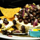 Easy Layered Black Bean Dip - Black beans, cream cheese, lime juice, and a blend of spices make this recipe for layered black bean dip a guaranteed crowd-pleaser!