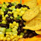 Jennifer's Corn Salad - Corn salad with black beans, feta cheese, and green onions is a colorful and crowd-pleasing side dish for any meal or party.