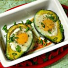 Paleo Baked Eggs in Avocado - Baked eggs in avocado halves are topped with bacon creating a delicious and satisfying paleo breakfast or snack.