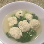 He Jia Tuan Yuan (Tofu Ball Soup for Lunar Chinese New Year) - Tofu and ground pork make round balls that are simmered in a savory soup which is served with a finishing touch of fresh pea vine shoots and Chinese dried shrimp. It's a family tradition for Chinese New Year.