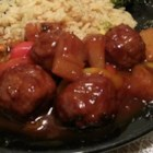 Sweet and Sour Meatballs I - This is a slow-cooker recipe for meatballs made of ground beef combined with onion and egg. They are simmered for 4 to 5 hours with chili sauce, grape jelly, and lemon juice.