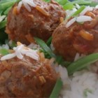 Slow Cooker Porcupine Meatballs With Peppers - Meatballs studded with rice cook for hours in a slow cooker with tomato sauce and peppers.