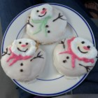Melted SnowMan Cookie - Sugar cookies topped with icing and a melted marshmallow make for clever 'melted snowman' cookies when you decorate them with chocolate and colored icing.