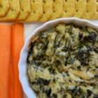 Spinach Artichoke Dip with Water Chestnuts - Spinach and artichoke dip gets an extra crunch when water chestnuts are stirring into the mix; serve with chips or Hawaiian bread.