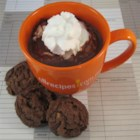 Homemade Hot Chocolate - Hot chocolate using real chocolate instead of the powdered stuff. Top with whipped cream and chocolate shavings and enjoy!