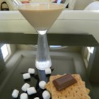 S'Moretini - Marshmallow vodka, Irish cream, chocolate liqueur, and half-and-half combine to give you your favorite campfire treat in cocktail form.