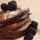 Chocolate Pancakes - This is a sweet and slightly gooey chocolate pancake that is great with fresh fruit.