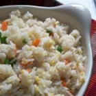 Fried Rice Restaurant Style - A great way to use up leftover rice, this quick fried rice cooks up with frozen peas, baby carrots, eggs, and soy and sesame sauces.