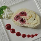 Raspberry and White Chocolate Roll - A delicious white chocolate cream cheese filling is topped with raspberries and rolled up in a meringue crust to create this easy yet delicious dessert.