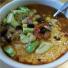 Spicy Tortilla Bean Soup - Spicy tortilla soup with plenty of beans and spices is a warm meal to serve on cold winter evenings. Add lime juice, Cheddar cheese, and avocado!