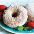 Coconut Vanilla Doughnuts - These oven-baked homemade doughnuts are sugar glazed then dusted with coconut flakes.