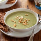 Roasted Garlic Avocado Soup with Herbed Yogurt Crackers - Roasted garlic infuses this chilled avocado soup topped with chopped cashews and served with crunchy herb crackers.