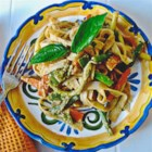 Peanut-Free Tahini Vegetable Noodle Stir Fry - This Thai-inspired stir fry is loaded with fresh veggies quickly cooked in a red curry sauce with ginger and coconut milk.