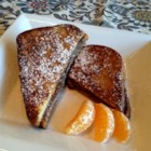 Nutella(R)-Stuffed French Toast - Make sandwiches from chocolate-hazelnut spread and cinnamon bread and then turn them into French toast for a delicious breakfast treat.