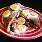 Banana and Nutella(R) French Toast - French toast is made in a chocolate milk batter and topped with bananas and Nutella(R) for an extra breakfast or dessert treat.