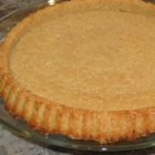 Pecan Nut Crust -  This fabulous baked pie crust made from ground pecans, sugar, cinnamon and butter, promising a nice taste to contrast any smooth and creamy custard pie. It 's perfect for an ice cream pie, topped with caramel sauce. Or a lemony, cream cheese filling would be smashing.