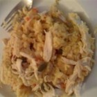 Awesome Chicken and Yellow Rice Casserole - This Cuban influenced dish has been a family favorite for generations! Chicken baked with onions, bell peppers, and water chestnuts, then added to prepared yellow rice makes this dish one you'll be asked again and again to make!