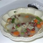 Turkey Frame Vegetable Soup - This recipe for turkey soup with carrots, turnips, green beans and peas begins by making a stock from a turkey carcass.  Canned kidney beans are included in this soup seasoned with thyme and fresh parsley.
