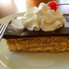 Chocolate Eclair - The 24-hour chilling period is well worth the wait for this delectable concoction. A hearty graham cracker mixture and a vanilla pudding mixture alternate layers in a large 9x12-inch pan. Chocolate frosting is then heated and poured over the top.
