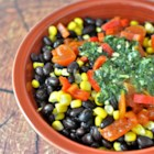 Mexican Green Papaya Salad - Green papaya, black beans, and corn are the primary of this salad dressed with a freshly made cilantro vinaigrette.