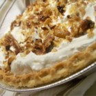 Toasted Coconut, Pecan, and Caramel Pie - The filling for this decadent pie is a combination of a very creamy, cream cheese and whipped topping. Then toasted coconut and caramel sauce is sprinkled and drizzled over it. Another cream cheese layer is spooned on, and then the pie is finished with more toasted coconut. This recipe makes two fantastic pies.