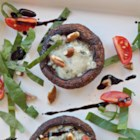 Roasted Portabello Mushrooms with Blue Cheese - Roasted portabello mushrooms topped with blue cheese and pine nuts are great as an appetizer or a fantastic vegetarian burger!