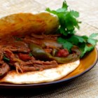 Easy Slow Cooker Ropa Vieja - The classic Cuban dish of beef in a tomato sauce, ropa vieja, is made simple with this easy slow cooker recipe.