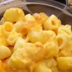 Classic Macaroni and Cheese - Elbow macaroni is layered with Cheddar cheese and baked with evaporated milk in this easy classic.
