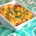 Sweet Corn Casserole - Canned whole kernel corn and cream-style corn mix with egg, sugar, and buttery round crackers in this quick and easy casserole dish.
