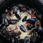 Mussels Marinara di Amore - Steam fresh mussels in a fragrant, spicy and easy-to-make melange of garlic, tomatoes, oregano, basil, pepper flakes and wine. Buy fresh mussels from a reputable source, and discard any that do not open during steaming.