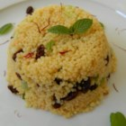 Saffron Couscous - Saffron couscous, tossed with currants and seasoned with cumin and harissa, is a light side dish or a hearty lunch.