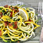 Refreshing Summer Squash Salad - With a fresh mint and lemon dressing, crispy prosciutto, and crumbled feta cheese, shaved yellow squash and zucchini become a luscious summer salad.