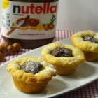 Nutella(R) Cups - Crescent roll dough is pressed into muffin cups and filled with bananas and Nutella(R) in this quick and easy Nutella(R) cup recipe.