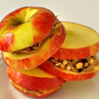 Easy-to-Make Apple Sandwich - Just sandwich peanut butter and granola between two apple slices for a simple snack that is fun to make with your kids.