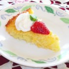 Mother's Day Pie - This crustless coconut cream pie 's lovely sweet filling is made with evaporated milk and coconut. This filling is poured into a prepared pie pan and baked until the custard is set and golden. Serve chilled with sliced strawberries.