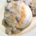 Bill's Sausage Gravy - Browned maple sausage is stirred into a creamy white gravy made with the sausage drippings. Pour over hot biscuits for a rich and hearty breakfast.