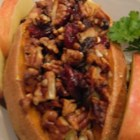 Drunken Stuffed Sweet Potatoes - Sweet potatoes are stuffed with apples, walnuts, and a generous pour of rum and baked into a sweet and drunk side dish perfect for the holiday season.