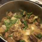 Filipino Oxtail Stew  - Filipino soul food combines oxtails, eggplant, and green beans in a peanut sauce. Serve over hot cooked rice.