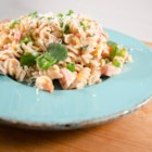 Fresh Summertime Bow-Tie Ham Salad - Bow-tie pasta and ham mix with bell pepper, tomato, and green onion in this mayonnaise-based picnic salad.