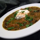 Pumpkin Black Bean Soup - This is a delicious soup that is even better reheated the next day. Easy to make too. Serve with a garnish of sour cream and toasted pumpkin seeds if desired.